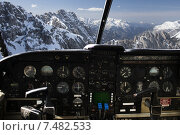 dashboard in airplane cockpit and mountains view. Стоковое фото, фотограф Syda Productions / Фотобанк Лори