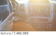 Купить «Женская рука включает радио в автомобиле, солнечный яркий контровой свет, крупный план», видеоролик № 7486989, снято 23 марта 2015 г. (c) Кекяляйнен Андрей / Фотобанк Лори