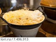 Купить «bowl of rice noodles garnish at asian restaurant», фото № 7496913, снято 15 февраля 2015 г. (c) Syda Productions / Фотобанк Лори