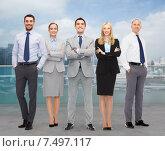 Купить «group of smiling businessmen over city background», фото № 7497117, снято 15 марта 2014 г. (c) Syda Productions / Фотобанк Лори