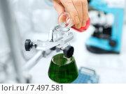 Купить «close up of scientist filling test tubes in lab», фото № 7497581, снято 4 декабря 2014 г. (c) Syda Productions / Фотобанк Лори