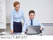 Купить «smiling businesspeople with laptop in office», фото № 7497617, снято 25 октября 2014 г. (c) Syda Productions / Фотобанк Лори