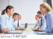 Купить «smiling business people having conflict in office», фото № 7497621, снято 25 октября 2014 г. (c) Syda Productions / Фотобанк Лори