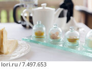 Купить «close up of tea time set with jam on table», фото № 7497653, снято 21 февраля 2015 г. (c) Syda Productions / Фотобанк Лори