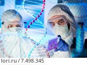 Купить «close up of scientists making test in chemical lab», фото № 7498345, снято 4 декабря 2014 г. (c) Syda Productions / Фотобанк Лори