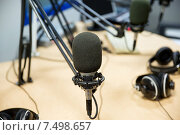 Купить «microphone at recording studio or radio station», фото № 7498657, снято 8 апреля 2015 г. (c) Syda Productions / Фотобанк Лори