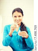Купить «beautiful woman polishing her nails», фото № 7498769, снято 18 июня 2011 г. (c) Syda Productions / Фотобанк Лори