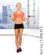 smiling sporty woman jumping with skipping rope. Стоковое фото, фотограф Syda Productions / Фотобанк Лори