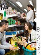 Купить «Customers choosing seed-oil at shop», фото № 7524733, снято 17 февраля 2020 г. (c) Яков Филимонов / Фотобанк Лори
