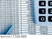 Купить «Финансовые таблицы, калькулятор и ручка», фото № 7526889, снято 17 апреля 2015 г. (c) Валерия Потапова / Фотобанк Лори