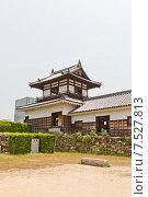 Купить «Башня Тайко Ягура замка Хиросима (Замок Карпа). Национальный исторический объект. Построен в 1591, разрушен атомной бомбой 1945 г., реконструирован в 1958 г.», фото № 7527813, снято 20 мая 2015 г. (c) Иван Марчук / Фотобанк Лори