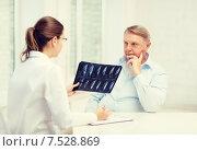 Купить «female doctor with old man looking at x-ray», фото № 7528869, снято 12 октября 2013 г. (c) Syda Productions / Фотобанк Лори