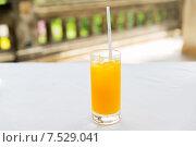 Купить «glass of fresh orange fruit juice at restaurant», фото № 7529041, снято 21 февраля 2015 г. (c) Syda Productions / Фотобанк Лори