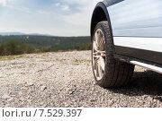 Купить «close up of dirty car wheel on cliff», фото № 7529397, снято 28 марта 2015 г. (c) Syda Productions / Фотобанк Лори