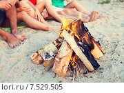 Купить «close up of friends sitting on summer beach», фото № 7529505, снято 3 августа 2014 г. (c) Syda Productions / Фотобанк Лори