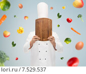 Купить «male chef cook covering face with cutting board», фото № 7529537, снято 7 марта 2015 г. (c) Syda Productions / Фотобанк Лори