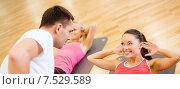 Купить «group of smiling women doing sit ups in the gym», фото № 7529589, снято 28 сентября 2013 г. (c) Syda Productions / Фотобанк Лори
