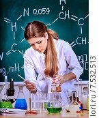 Купить «Chemistry teacher at classroom.», фото № 7532513, снято 15 сентября 2013 г. (c) Gennadiy Poznyakov / Фотобанк Лори