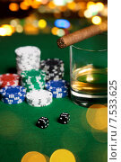 Купить «close up of chips, dice, whisky and cigar on table», фото № 7533625, снято 17 октября 2014 г. (c) Syda Productions / Фотобанк Лори