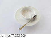 Купить «sugar bowl and saucer with spoon on table», фото № 7533769, снято 21 февраля 2015 г. (c) Syda Productions / Фотобанк Лори
