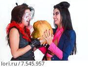 Купить «Девушки, наряженные для Хэллоуина, с тыквой», фото № 7545957, снято 13 октября 2012 г. (c) 1Andrey Милкин / Фотобанк Лори