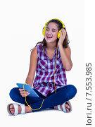Купить «Pretty brunette listening music with her tablet computer», фото № 7553985, снято 19 марта 2015 г. (c) Wavebreak Media / Фотобанк Лори