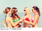 Купить «group of smiling young women drinking on beach», фото № 7554533, снято 26 июля 2014 г. (c) Syda Productions / Фотобанк Лори