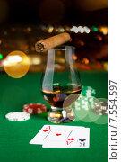 Купить «close up of chips, cards whisky and cigar on table», фото № 7554597, снято 17 октября 2014 г. (c) Syda Productions / Фотобанк Лори