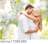 Купить «happy couple hugging over blooming summer garden», фото № 7555093, снято 14 июля 2013 г. (c) Syda Productions / Фотобанк Лори
