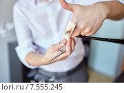 Купить «male stylist hands cutting hair tips at salon», фото № 7555245, снято 15 февраля 2015 г. (c) Syda Productions / Фотобанк Лори