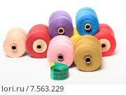 Купить «Катушки с разноцветными нитками и сантиметр на белом фоне», эксклюзивное фото № 7563229, снято 14 июня 2015 г. (c) Яна Королёва / Фотобанк Лори