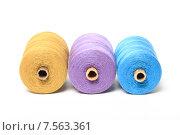 Купить «Три большие катушки с разноцветными нитками на белом фоне», эксклюзивное фото № 7563361, снято 14 июня 2015 г. (c) Яна Королёва / Фотобанк Лори