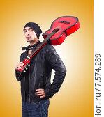 Купить «Guitar player against the gradient», фото № 7574289, снято 11 февраля 2013 г. (c) Elnur / Фотобанк Лори