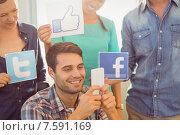 Купить «Colleagues holding sign from famous social networks», фото № 7591169, снято 22 марта 2015 г. (c) Wavebreak Media / Фотобанк Лори