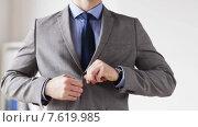 Купить «close up of man in suit fastening button on jacket», видеоролик № 7619985, снято 12 апреля 2015 г. (c) Syda Productions / Фотобанк Лори