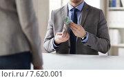 Купить «close up of businessman taking money bribe», видеоролик № 7620001, снято 12 апреля 2015 г. (c) Syda Productions / Фотобанк Лори