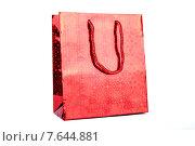 Красный блестящий подарочный пакет на белом фоне. Стоковое фото, фотограф Владимир Ходатаев / Фотобанк Лори