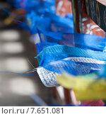 Купить «Prayer flags on display at an outdoor market in Thimphu, Bhutan», фото № 7651081, снято 15 октября 2010 г. (c) Ingram Publishing / Фотобанк Лори