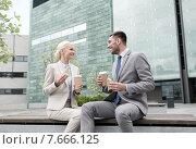Купить «smiling businessmen with paper cups outdoors», фото № 7666125, снято 19 августа 2014 г. (c) Syda Productions / Фотобанк Лори