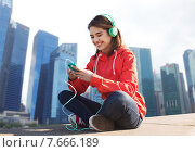 happy young woman with smartphone and headphones. Стоковое фото, фотограф Syda Productions / Фотобанк Лори