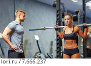 Купить «man and woman with barbell flexing muscles in gym», фото № 7666237, снято 19 апреля 2015 г. (c) Syda Productions / Фотобанк Лори
