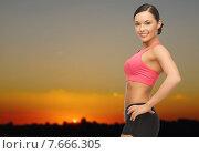 Купить «happy asian woman outdoors over sunset skyline», фото № 7666305, снято 12 января 2013 г. (c) Syda Productions / Фотобанк Лори