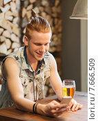 Купить «happy man with smartphone drinking beer at bar», фото № 7666509, снято 7 мая 2015 г. (c) Syda Productions / Фотобанк Лори