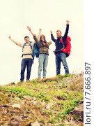 Купить «group of smiling friends with backpacks hiking», фото № 7666897, снято 31 августа 2014 г. (c) Syda Productions / Фотобанк Лори