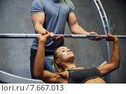 Купить «man and woman with barbell flexing muscles in gym», фото № 7667013, снято 19 апреля 2015 г. (c) Syda Productions / Фотобанк Лори