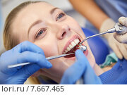 Купить «close up of dentist treating female patient teeth», фото № 7667465, снято 23 мая 2015 г. (c) Syda Productions / Фотобанк Лори