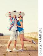 Купить «couple with skateboard kissing outdoors», фото № 7668245, снято 7 июля 2014 г. (c) Syda Productions / Фотобанк Лори