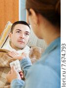 Купить «Woman giving pills to diseased guy», фото № 7674793, снято 27 марта 2019 г. (c) Яков Филимонов / Фотобанк Лори