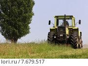 Купить «Hamm, Germany, Bauer mulches his pasture», фото № 7679517, снято 21 мая 2011 г. (c) Caro Photoagency / Фотобанк Лори