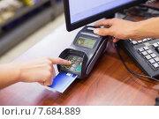 Купить «Woman paying with her credit card and doing his pin code», фото № 7684889, снято 21 января 2015 г. (c) Wavebreak Media / Фотобанк Лори